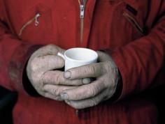 Lawrence has a 7am coffee break after feeding cattle.