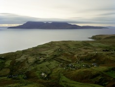 Dusk above Cleadale on the Isle of Eigg. Lights turn on powered by renewable energy.
